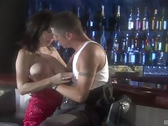 Brunette mature slut Rayveness fucked doggy at a public bar