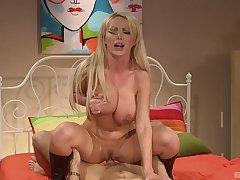 Nikki Benz strokes a big hard cock in advance she mounts plus rides it