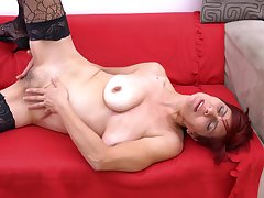 Shorthaired redhead of age amateur MILF Pauletta S. strips seductively