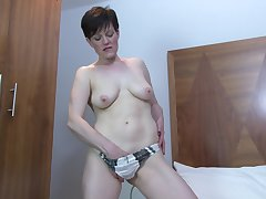Olivia G. takes out her vibrator and masturbates naked