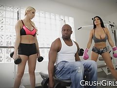 Kenzie and Romi share a big black cock at one's fingertips the gym