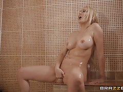 Blonde Amber Jayne takes a shower before a fuck in the matter of fishnet stockings